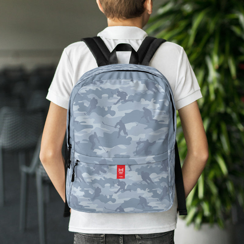 Camo Hockey Backpack In Grays. Facing side, model shot.