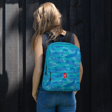 Female model wears Camo Backpack | Ocean | In Blues and Aquas. Front view.