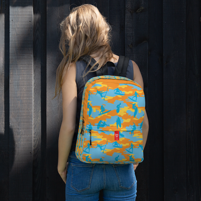 Female model wears Camo Backpack | Surf | In Yellow, Orange and Aquas. Front view.