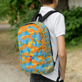 Boy wears Camo Backpack | Surf | In Yellow, Orange and Aquas. 3/4 view.