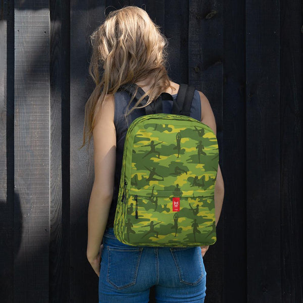 Female model wears Camo Backpack | Yoga | In Tropical greens. Front view.