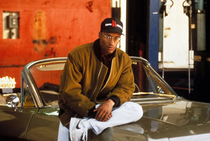 Photo of John Singleton wearing glasses