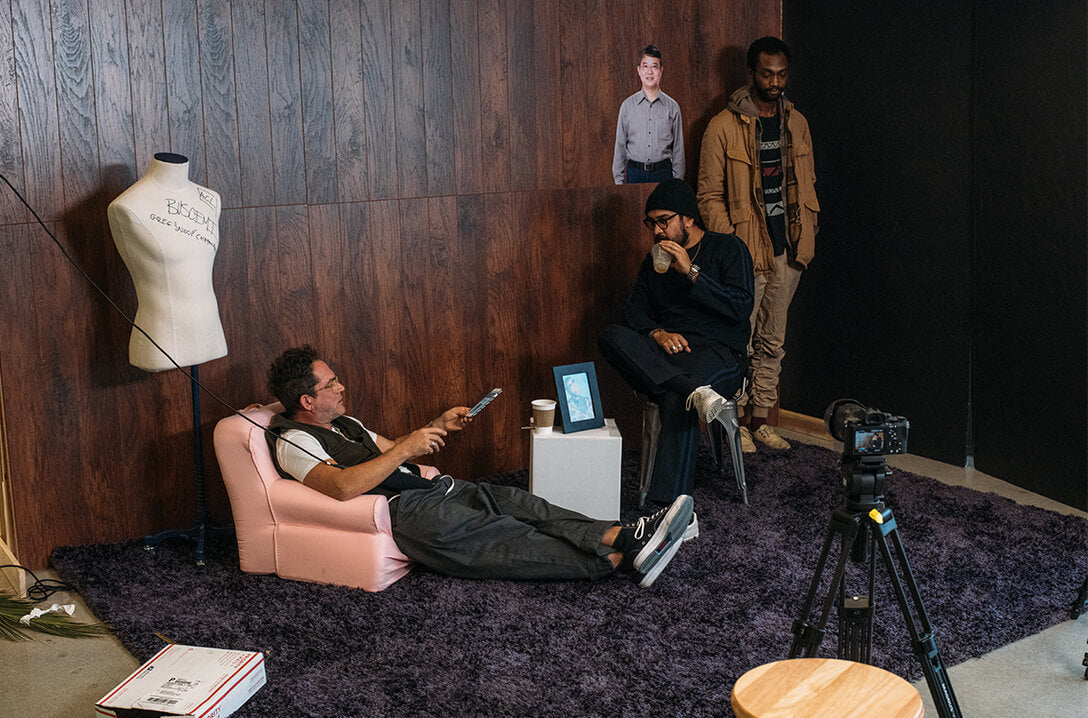 Garrett Leight and Mark McNairy chatting in office while filiming