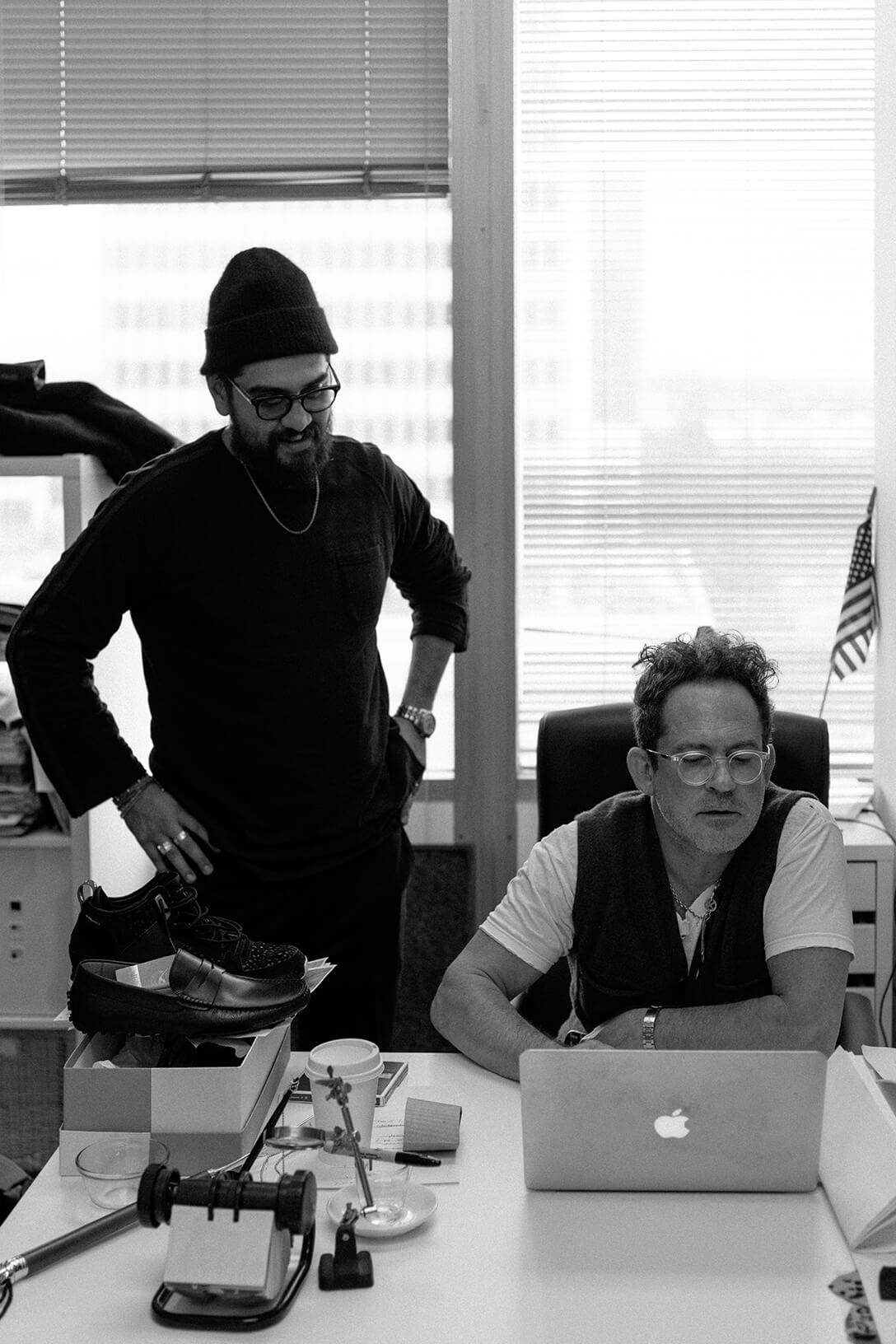 Garrett Leight and Mark McNairy in office looking at Macbook screen
