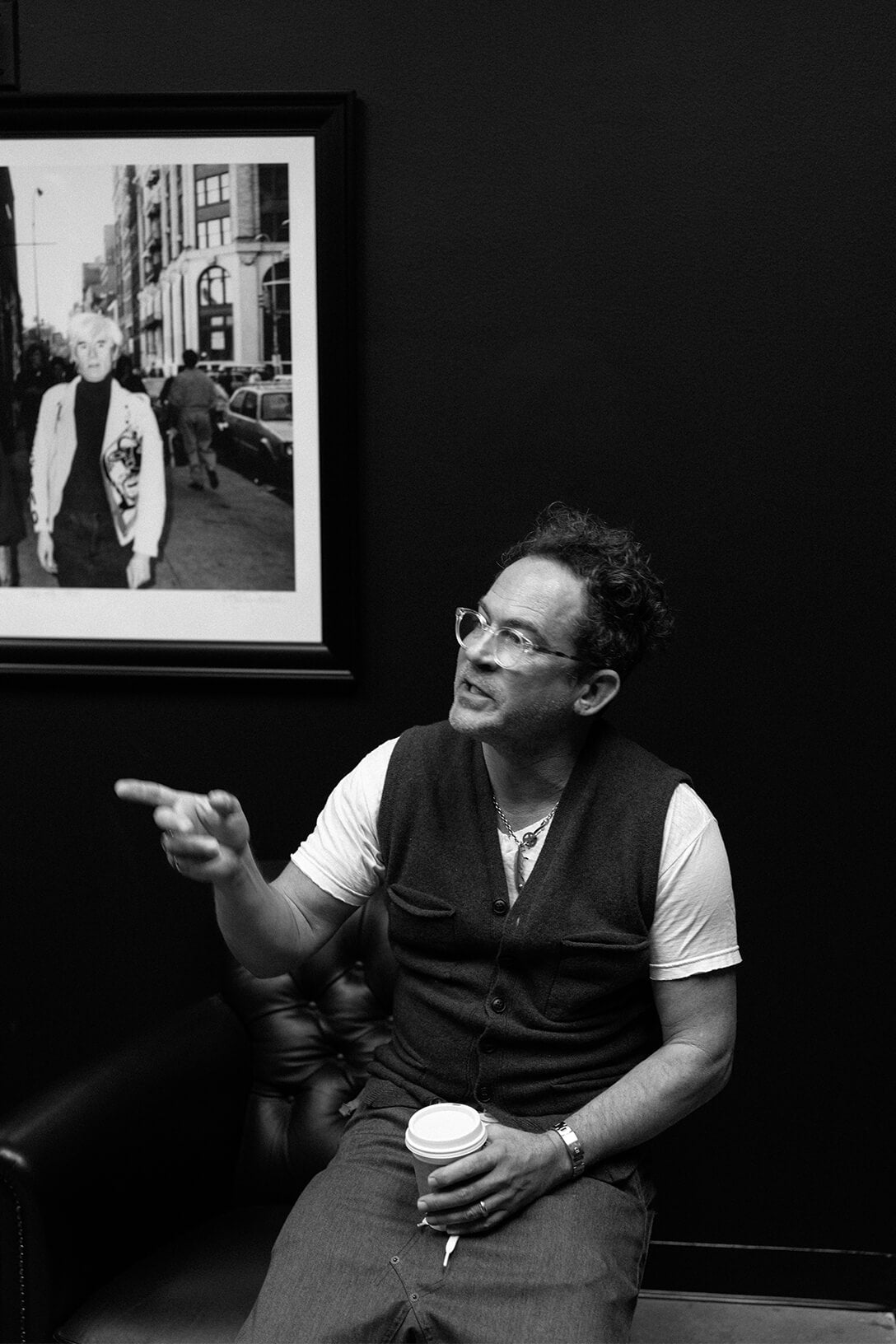 Mark McNairy speaking in front of framed photo