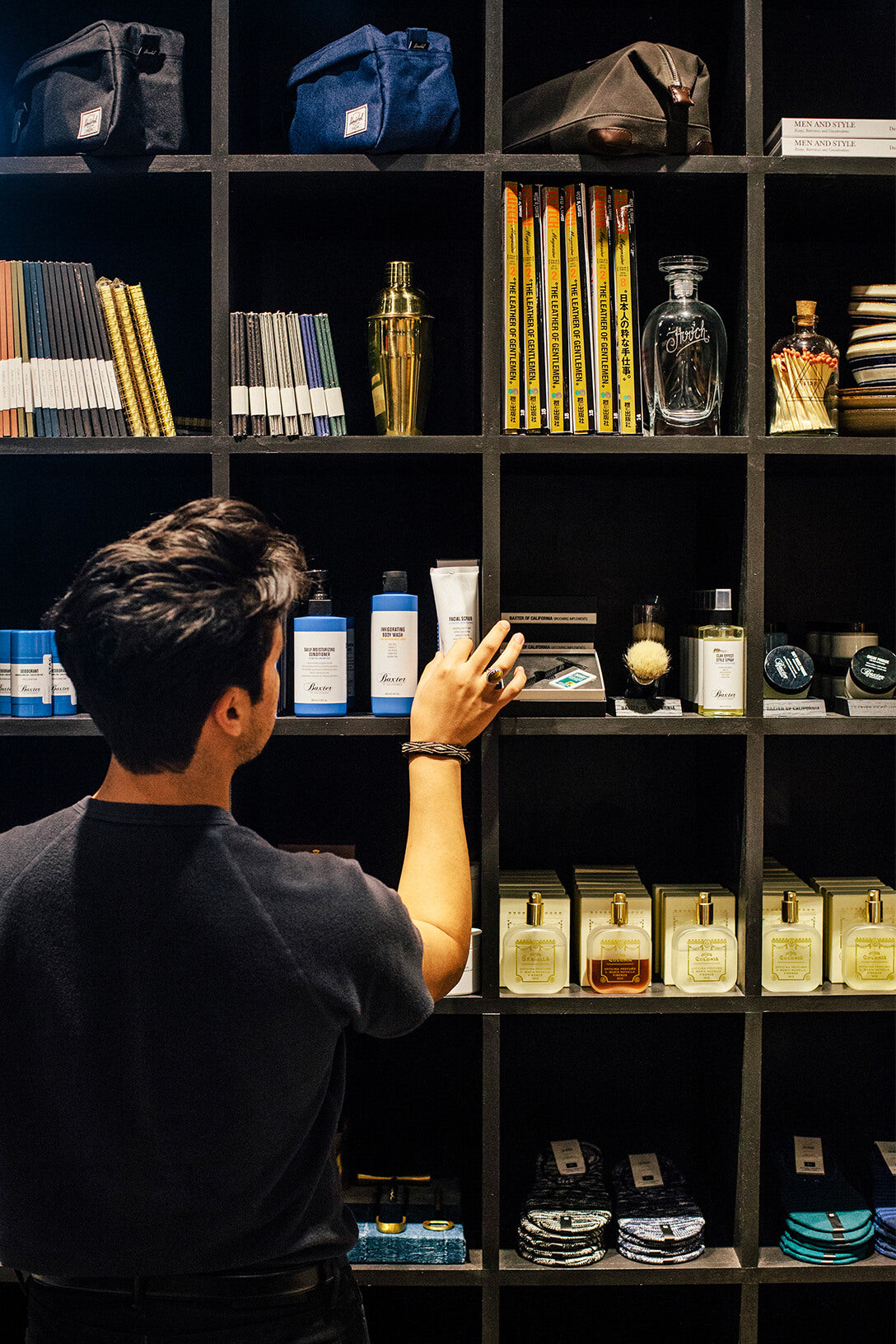 STAG employee restocking product on shelves