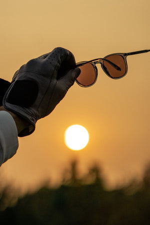 Golf glove and Garrett Leight California Optical Kinney sunglasses with SUV lenses.