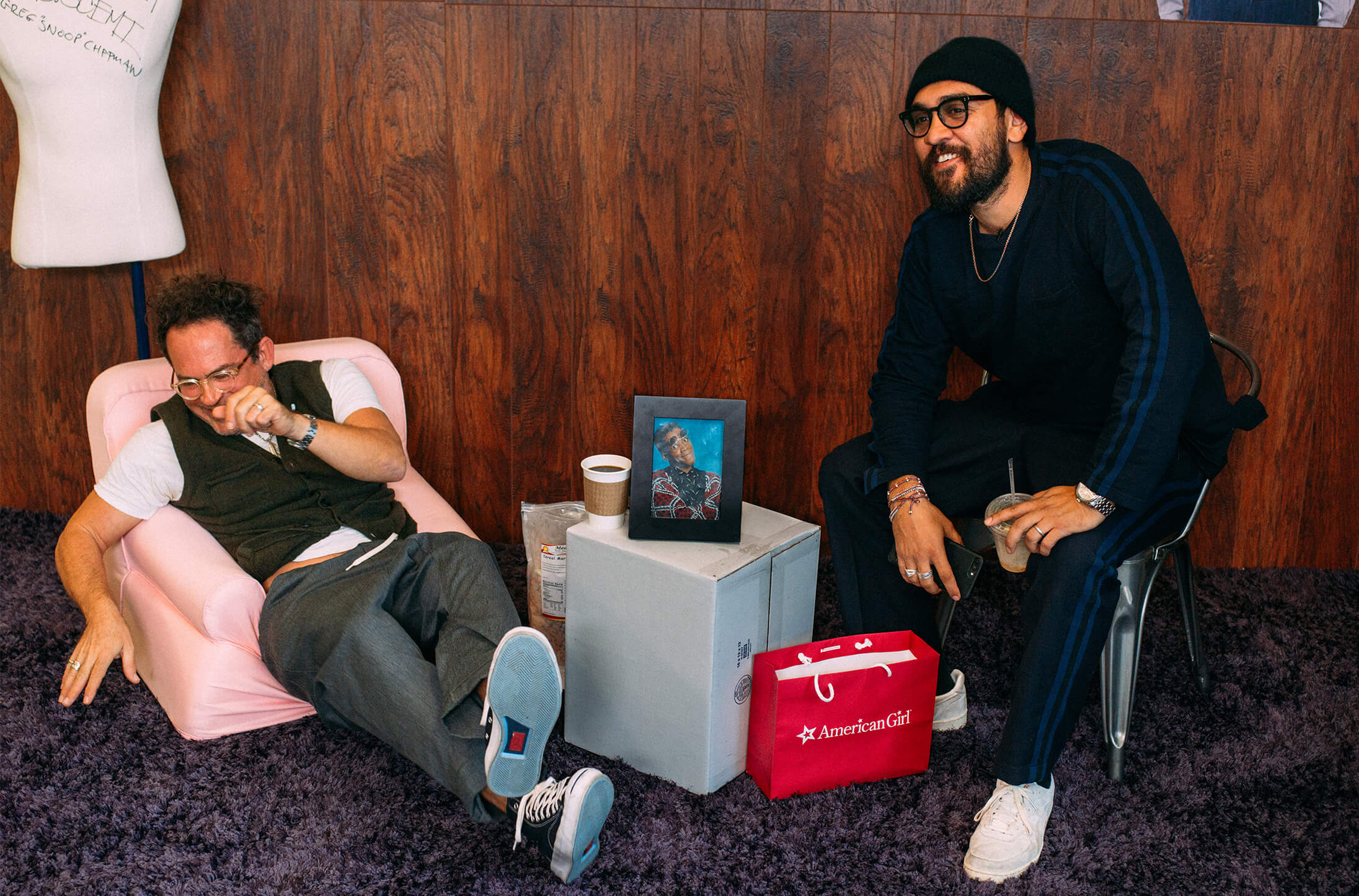 Garrett Leight and Mark McNairy laughing in office