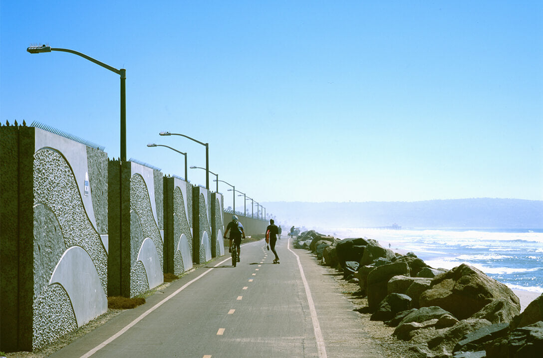 Surfers skateboarding and bicycling to Hammerland