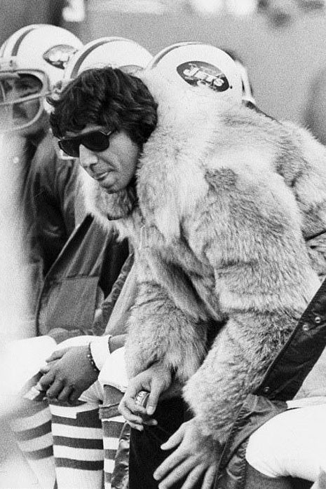 NFL player Joe Namath wearing sunglasses
