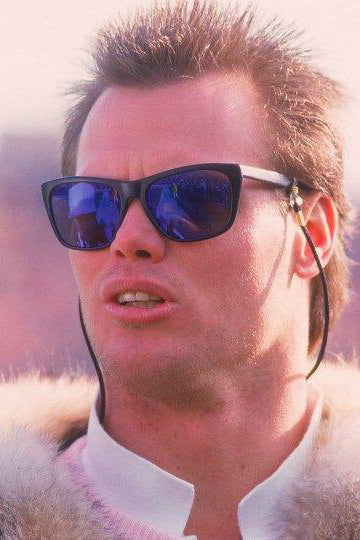 NFL player Jim McMahon wearing sunglasses