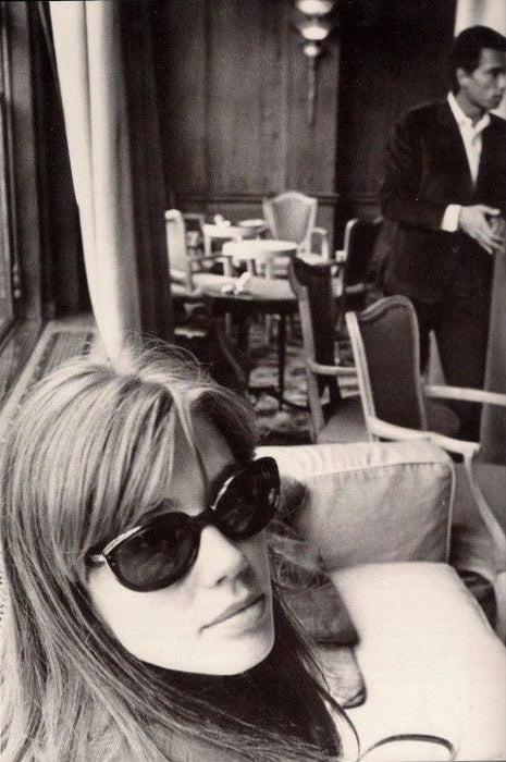 black and white photo of Francoise Hardy wearing sunglasses