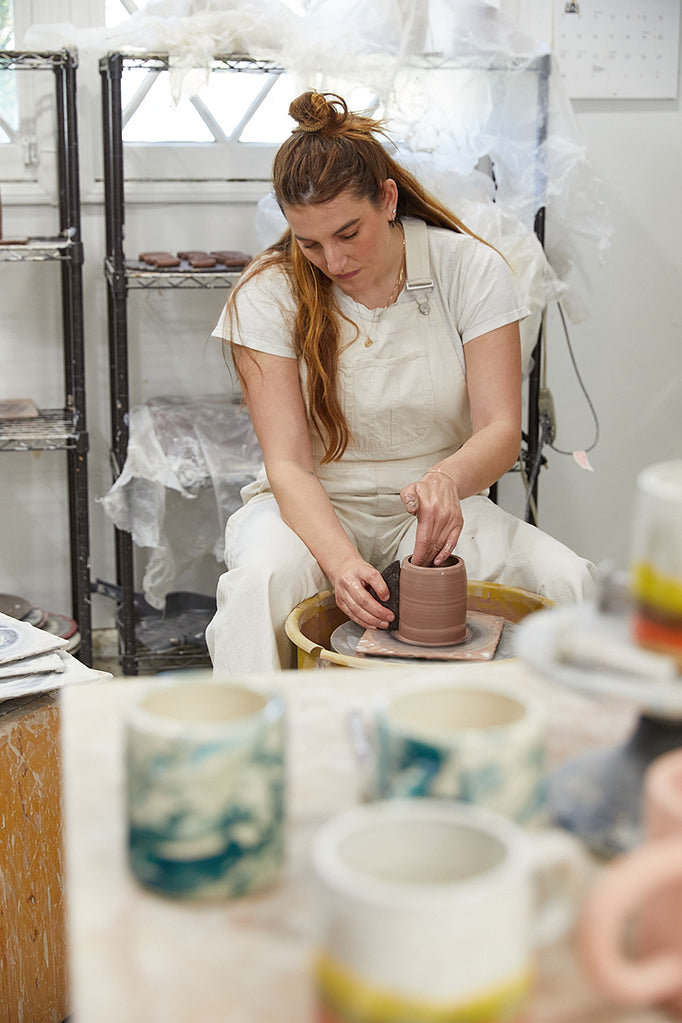 Lucy Michel creating ceramic mugs for GLCO collab