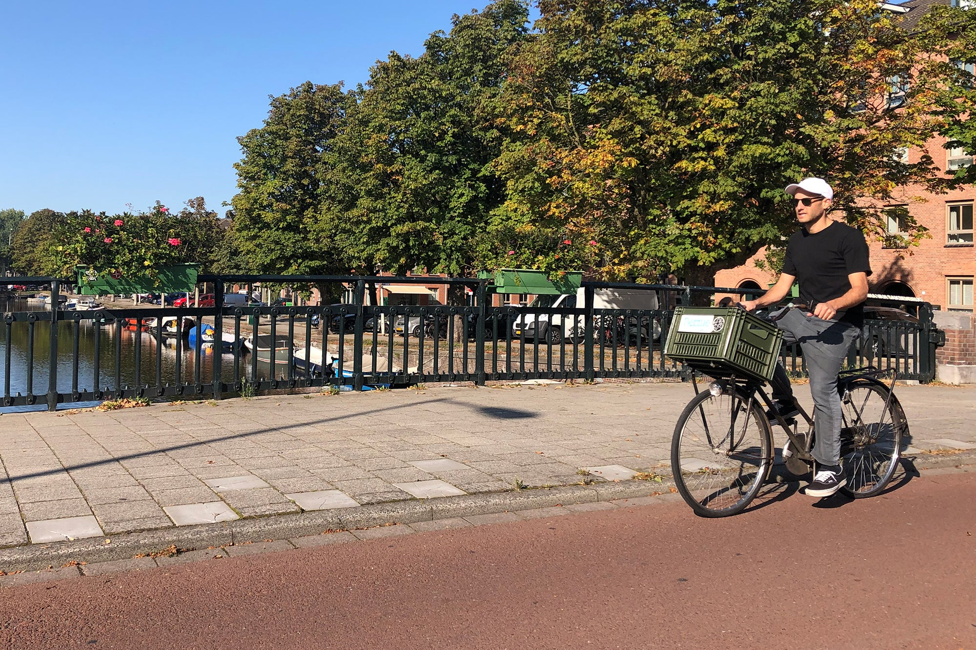 GLCO's Director of Operations Justin Steinhardt bike riding in Amsterdam.