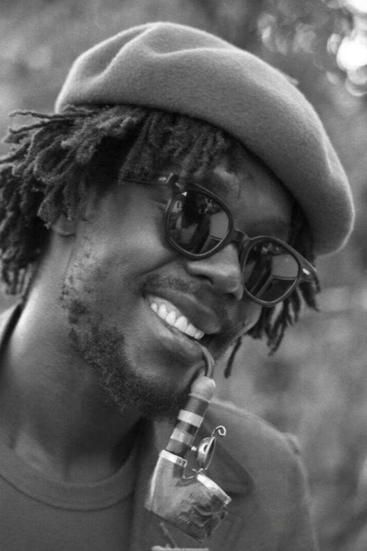 Old black-and-white photograph of Peter Tosh from the mid-1970s.