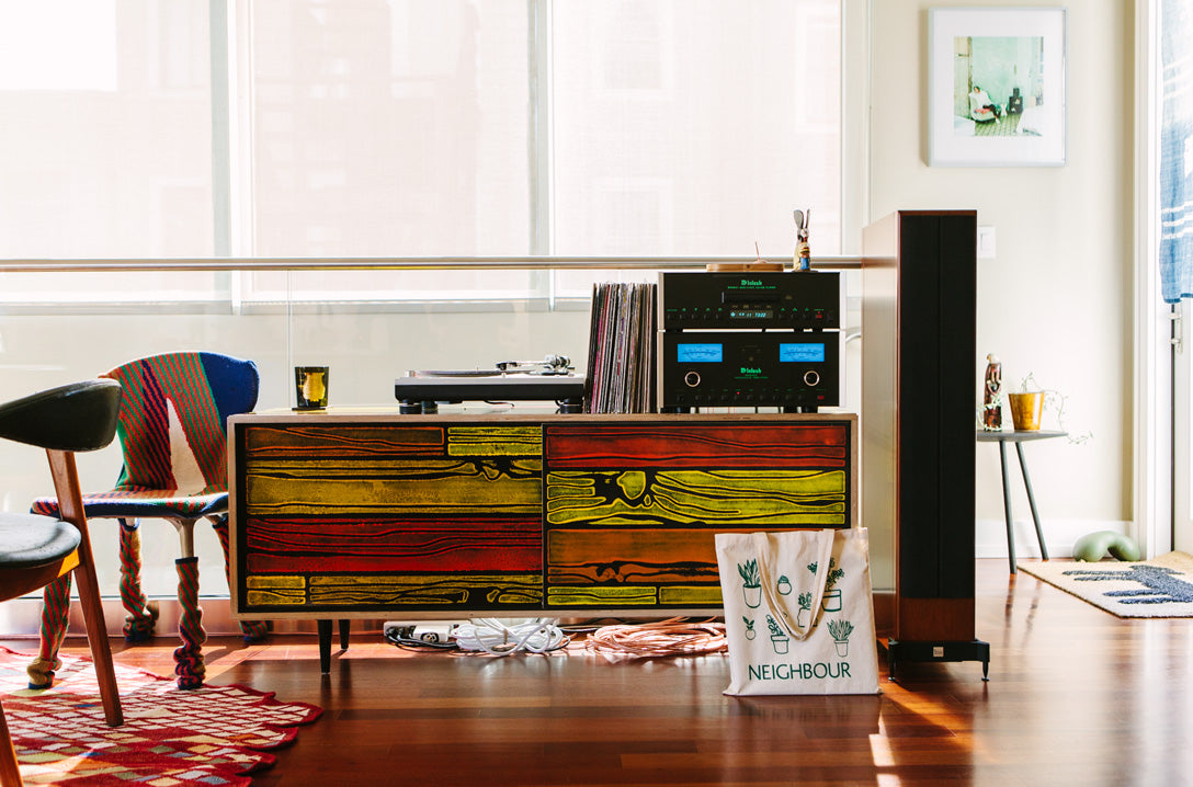 Record player and stereo system on top of console inside Eugene's home