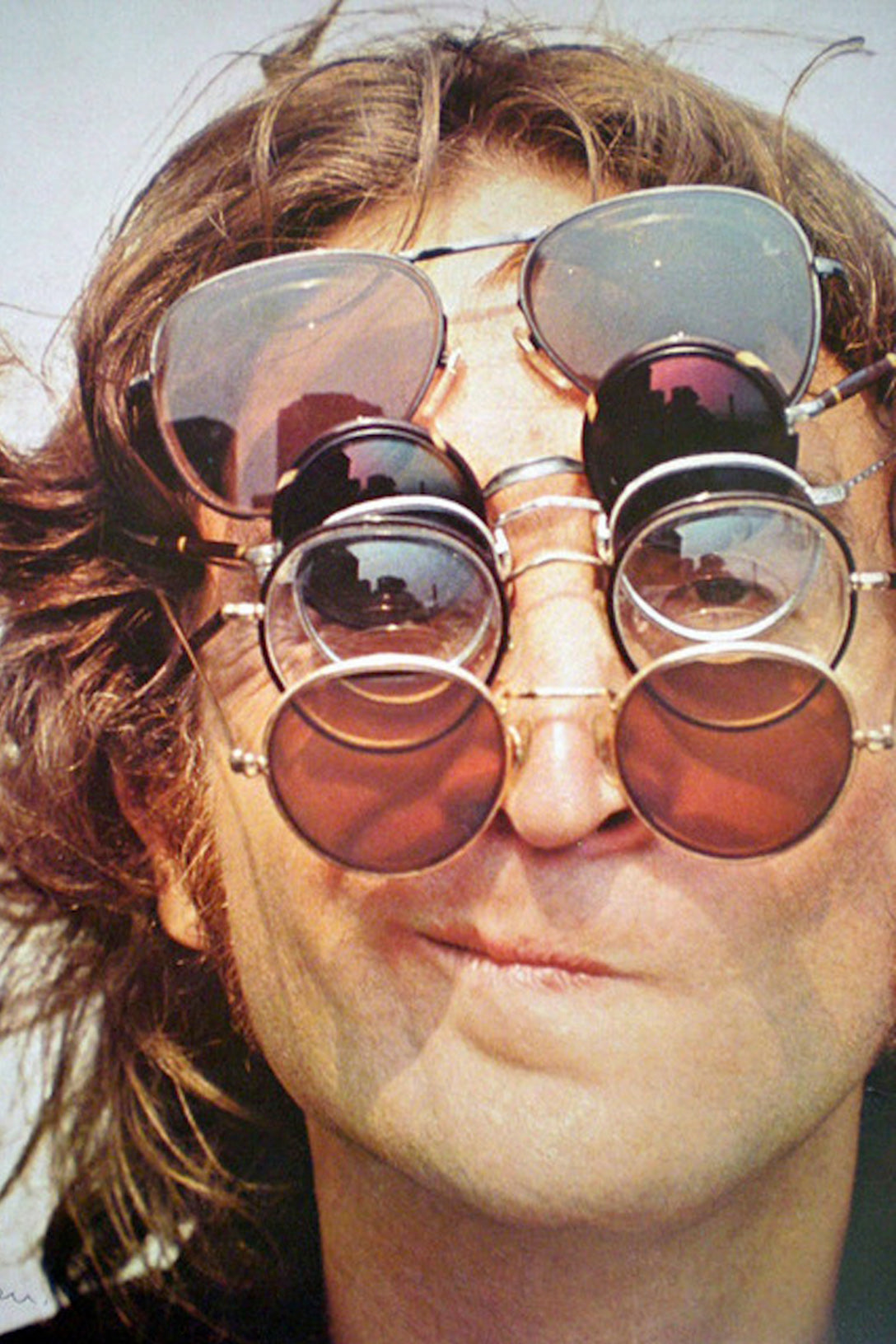 John Lennon wearing round sunglasses similar to GLCO Wilson M Sunglasses