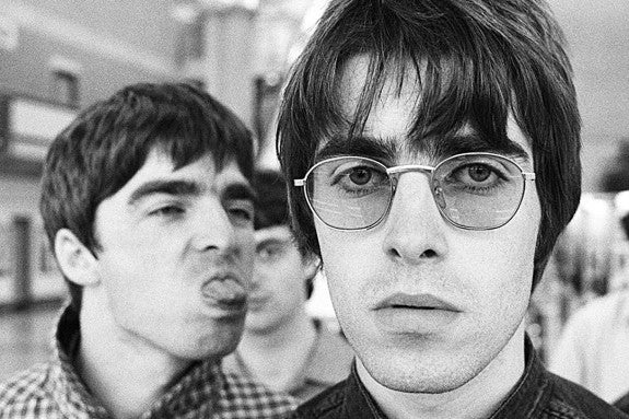 photo of Noel and Liam Gallagher of Oasis wearing sunglasses