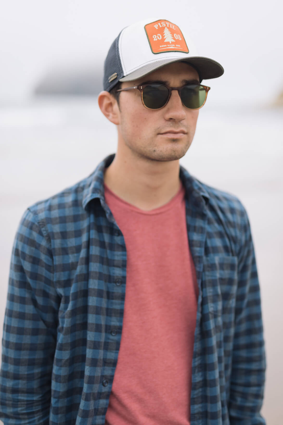 Man wearing Garrett Leight Round Milwood Sunglass in Matte Blonde Tortoise Fade with Pure G15 lenses