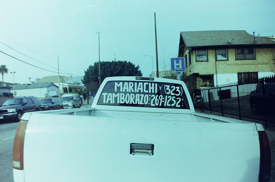 Pickup truck with mariachi advertisement in back window