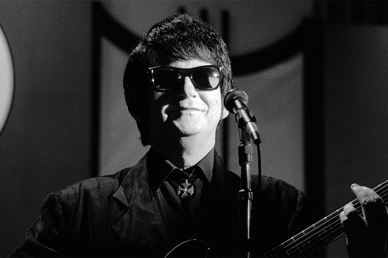 Black and white image of Roy Orbison singing