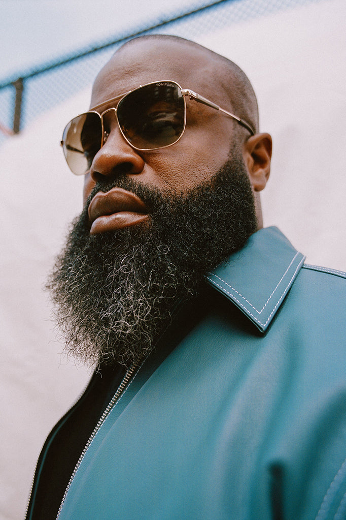 Black Thought wearing Tom Ford sunglasses and a blue leather jacket