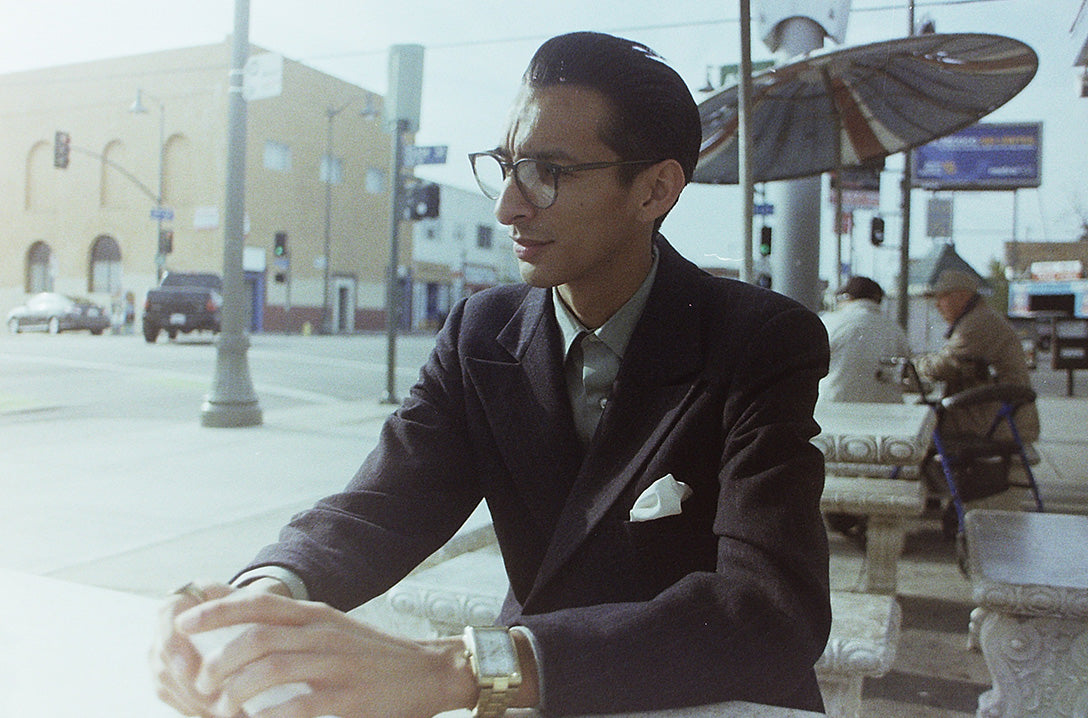 Man sitting at restaurant in tailored suit