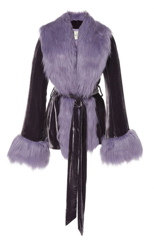 A Packshot Of Marei1998's Powderpuff Short Velvet Coat. The Silk Velvet Material In Dark Purple Color, Combined With Lilac Fur Trims, Creates A Contemporary Vintage Look. Featuring Wide Lapel Collar And Bell Sleeves, It Is Finished With A Self-Tie Belt To Define The Waist. Front View. Resort 2020 Collection - Furless Friendship.