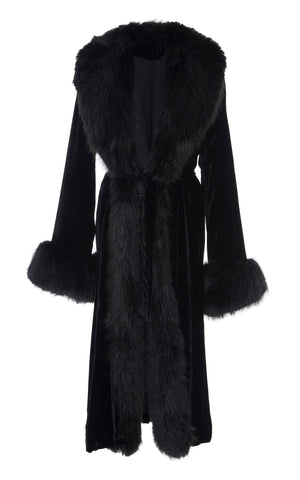 A Packshot Of Marei1998's Iconic Powderpuff Long Velvet Coat In Black Color. The Silk Velvet Material, Combined With Faux Fur Trims, Creates A Contemporary Vintage Look. Featuring Wide Lapel Collar And Bell Sleeves, It Is Finished With A Self-Tie Belt To Define The Waist. Front View. Resort 2020 Collection - Furless Friendship.