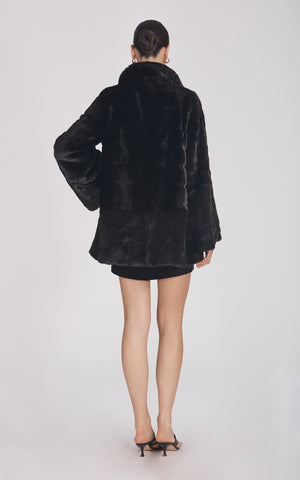 Marei1998's Yoshino Faux Fur Coat In Black Color. Cut In A Slight A-line Silhouette, It Features V-neckline And Bell Sleeves. Matching Tie-up Belt Defines The Waist. As Worn By The Model. Back View. Resort 2020 Collection - Furless Friendship.