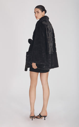 Marei1998's Yoshino Faux Fur Coat In Black Color. Cut In A Slight A-line Silhouette, It Features V-neckline And Bell Sleeves. Matching Tie-up Belt Defines The Waist. As Worn By The Model. Side View. Resort 2020 Collection - Furless Friendship.