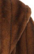 A zoomed view of the Marei 1998 Almond Cape showcasing the level of detail. Made from sumptuous faux fur, this Marei 1998 cape is an ideal winter piece. Hitting just below the waist, it adds a touch of glamour to every outfit. - Above the waist length- Concealed hook fastenings Composition 85% Acrylic, 15%.
