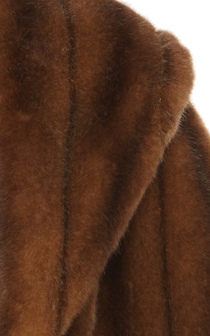 A close up view of Marei1998 Almond Eco Faux Fur Cape. Made from sumptuous Eco Faux Fur, this Marei1998 cape is an ideal winter piece. Hitting just below the waist, it adds a touch of glamour to every outfit. Composition: 85% Acrylic, 15% Polyester.