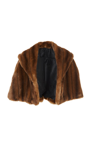 A front view of Marei1998 Almond Eco Faux Fur Cape. Made from sumptuous Eco Faux Fur, this Marei1998 cape is an ideal winter piece. Hitting just below the waist, it adds a touch of glamour to every outfit. Composition: 85% Acrylic, 15% Polyester.