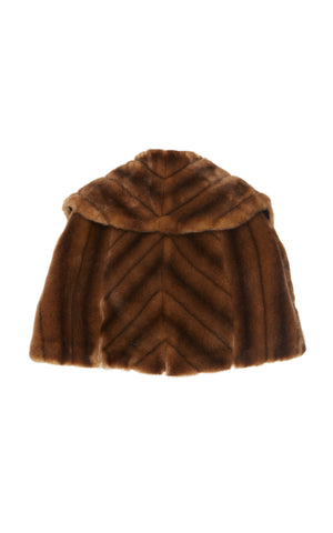 A back view of Marei1998 Almond Eco Faux Fur Cape. Made from sumptuous Eco Faux Fur, this Marei1998 cape is an ideal winter piece. Hitting just below the waist, it adds a touch of glamour to every outfit. Composition: 85% Acrylic, 15% Polyester.