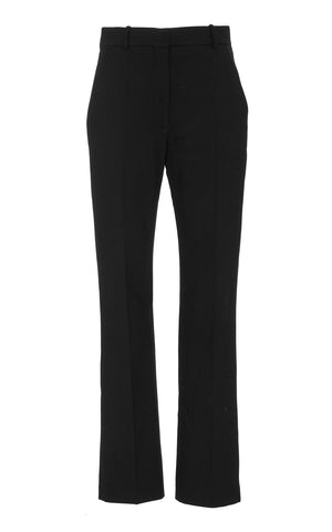 A back view of Marei1998 Amaryllis Wool Pants. Sharply cut, these Marei1998 classic wool pants feature a high waistline and fly closure. The tapered-leg silhouette provides a contemporary tailored feel. Wear yours with a matching jacket or as a sharp separate. Composition: 95% Wool, 5% Elastane.