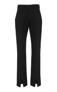 A front view of Marei1998 Amaryllis Wool Pants. Sharply cut, these Marei1998 classic wool pants feature a high waistline and fly closure. The tapered-leg silhouette provides a contemporary tailored feel. Wear yours with a matching jacket or as a sharp separate. Composition: 95% Wool, 5% Elastane.