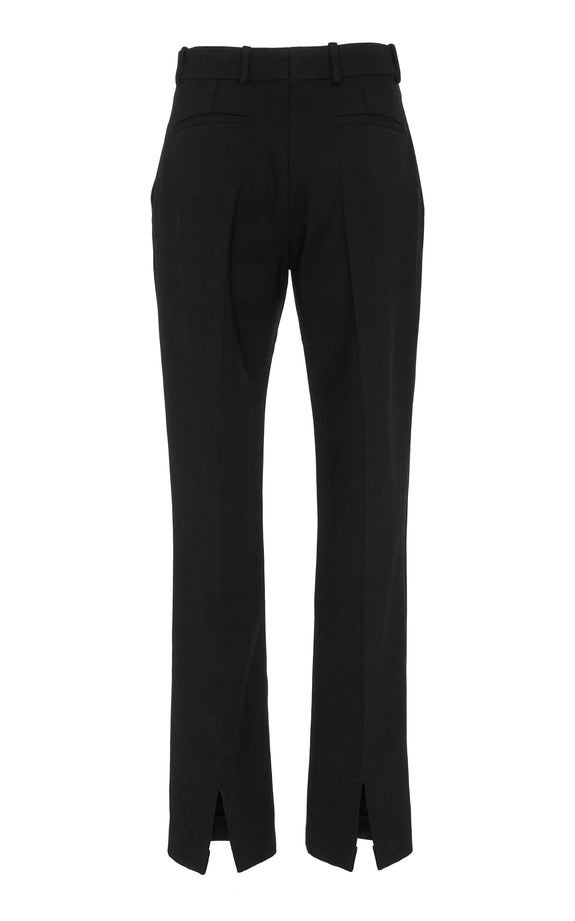 Front view of Amaryllis Pants. Demonstrating the Sharp cuts. Marei 1998 classic Wool Elastane pants feature a high waistline and fly closure.  The shape is straight which provides a contemporary feel. Designed by Maya Reik