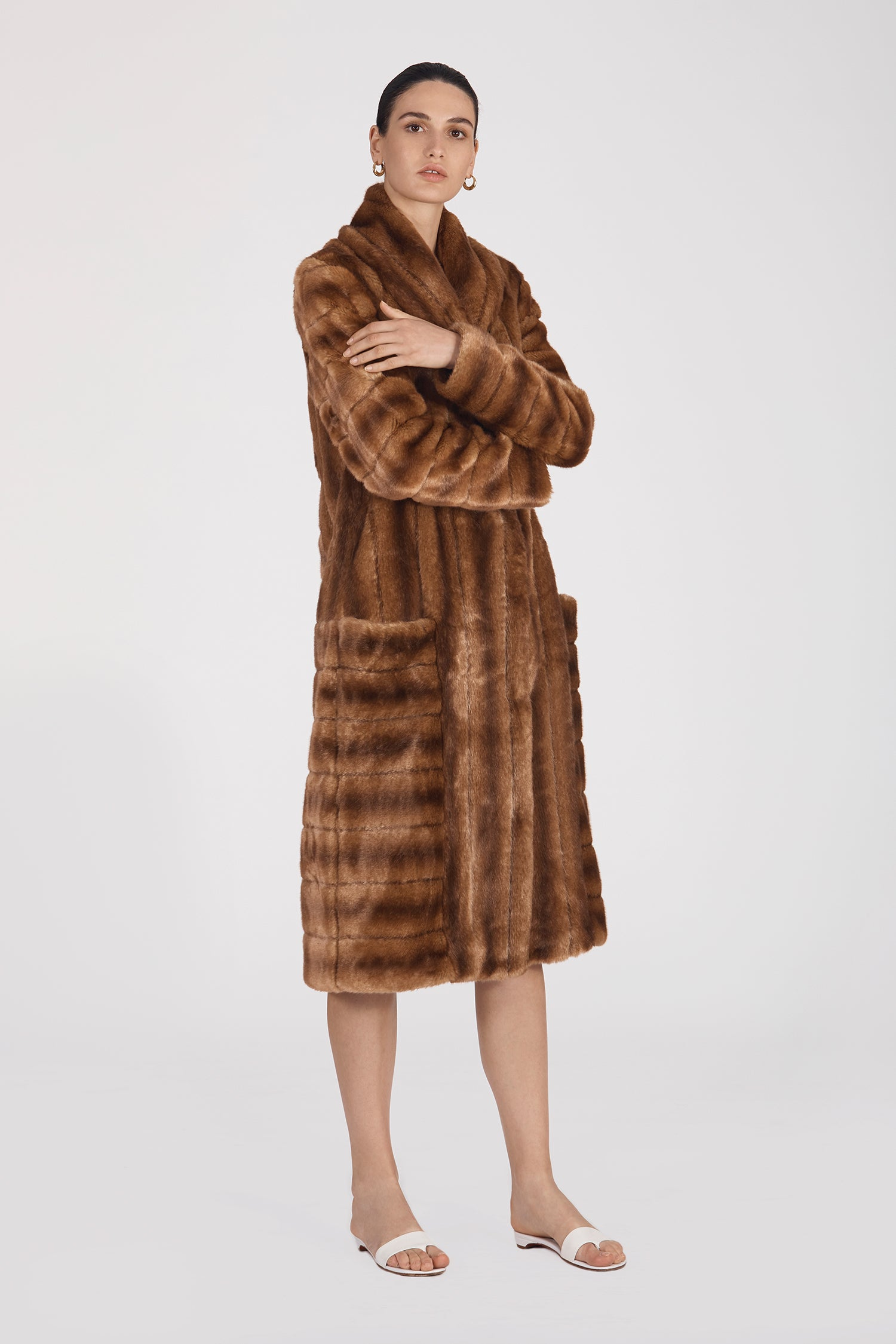 Marei1998's Timeless Echinacea Long Faux Fur Coat In Classic Brown Color. Featuring Oversized Silhouette And Wide Shawl Neckline. Investment Piece / Winter Essential. As Worn By The Model. Side View. Resort 2020 Collection - Furless Friendship.