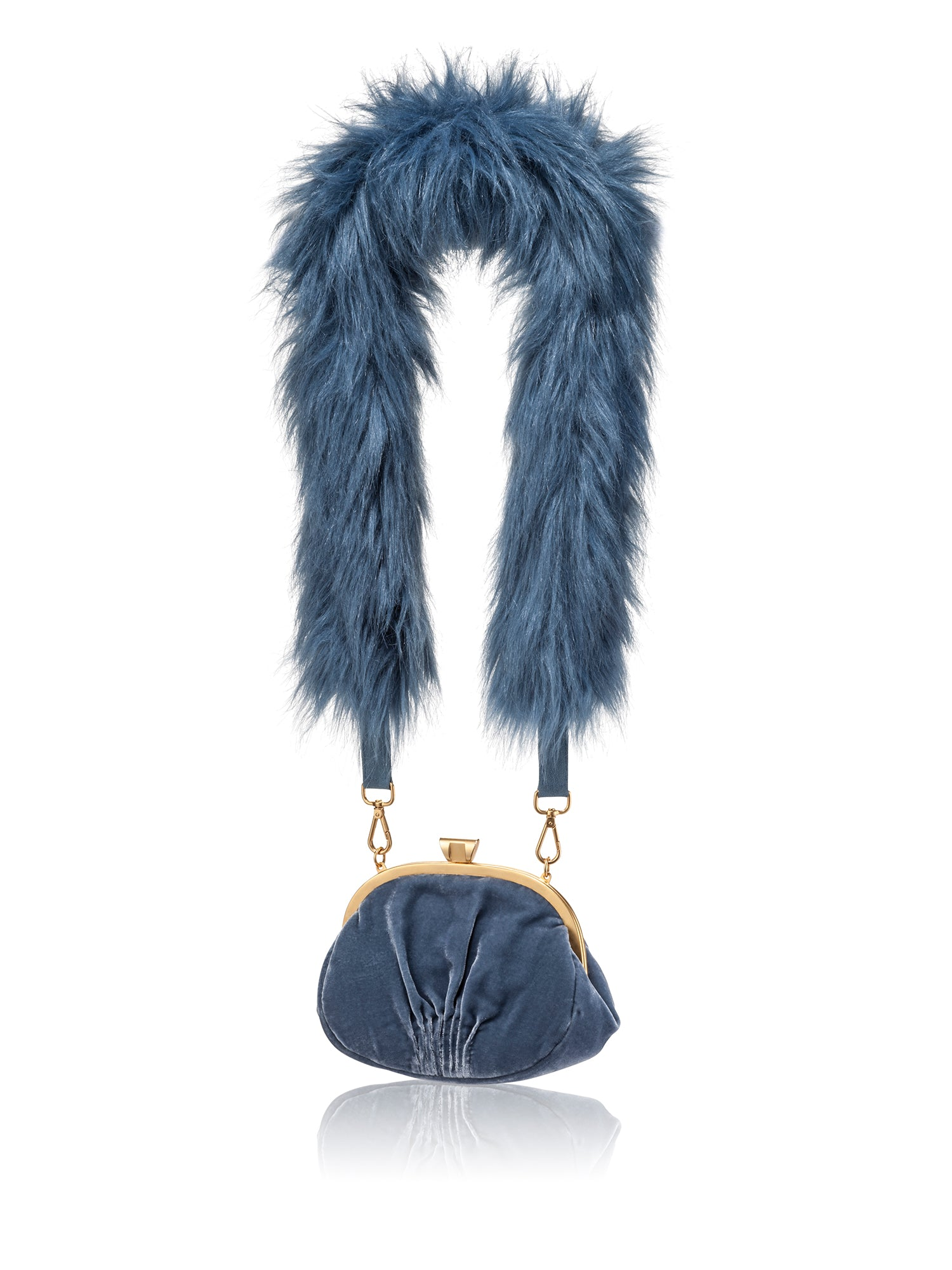 A Packshot Of Marei1998's Forget Me Not Velvet Purse In Light Blue Color. Made From Lustrous Velvet And Topped With Gold Plated Brass Clasp For Smooth Closure. The Puffy Silhouette In Light Blue Color Is Accentuated By A Lush Faux Fur Strap, Creating A Contemporary Vintage Look. Front View.