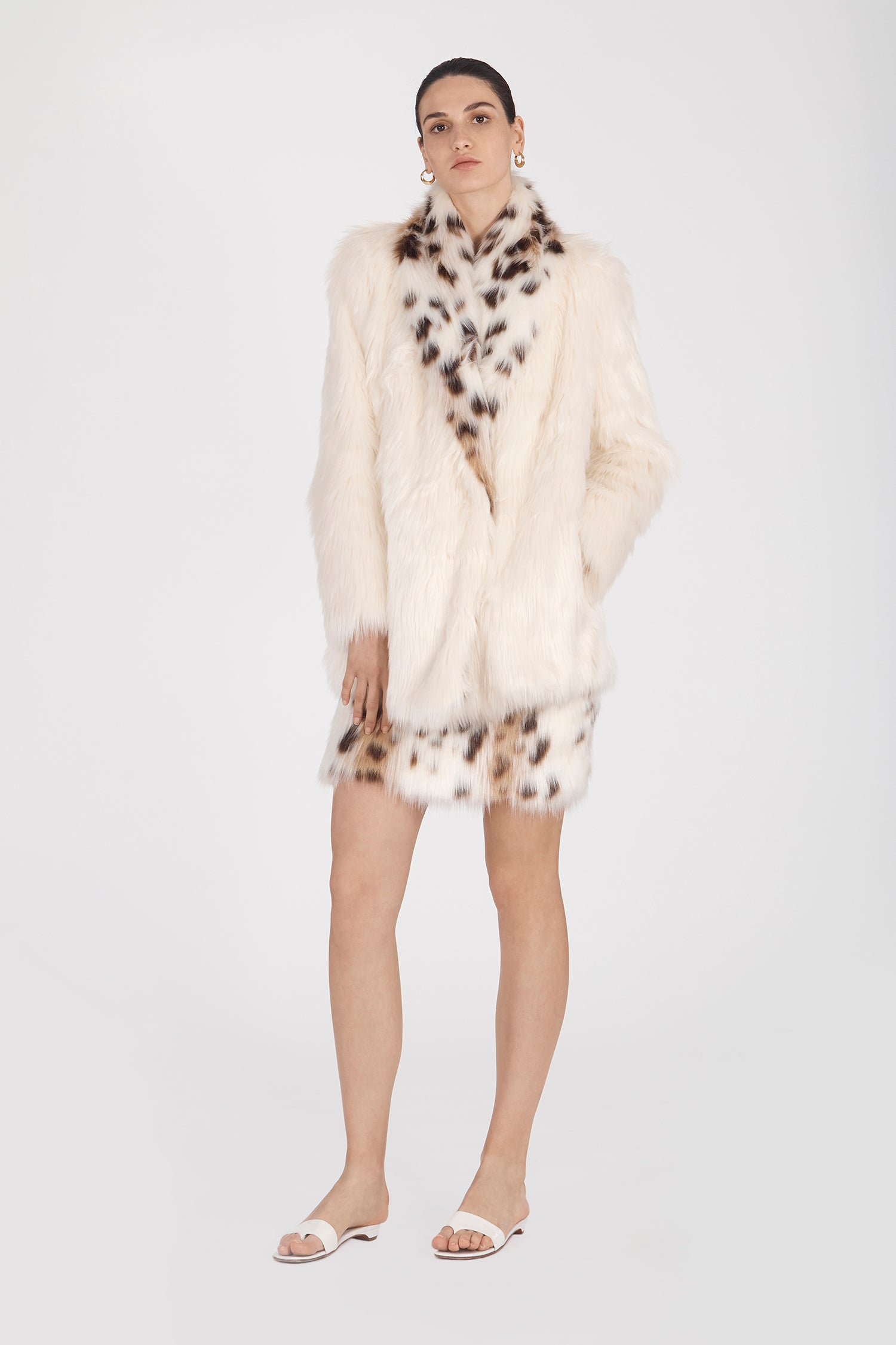 Marei1998's Tiger Lily Faux Fur Coat In White Color. Featuring Oversized Silhouette And Shawl Collar. Spotted Collar Design Contrasts The Elegant White Hue, Creating A Chic Look. As Worn By The Model. Front View. Resort 2020 Collection - Furless Friendship.