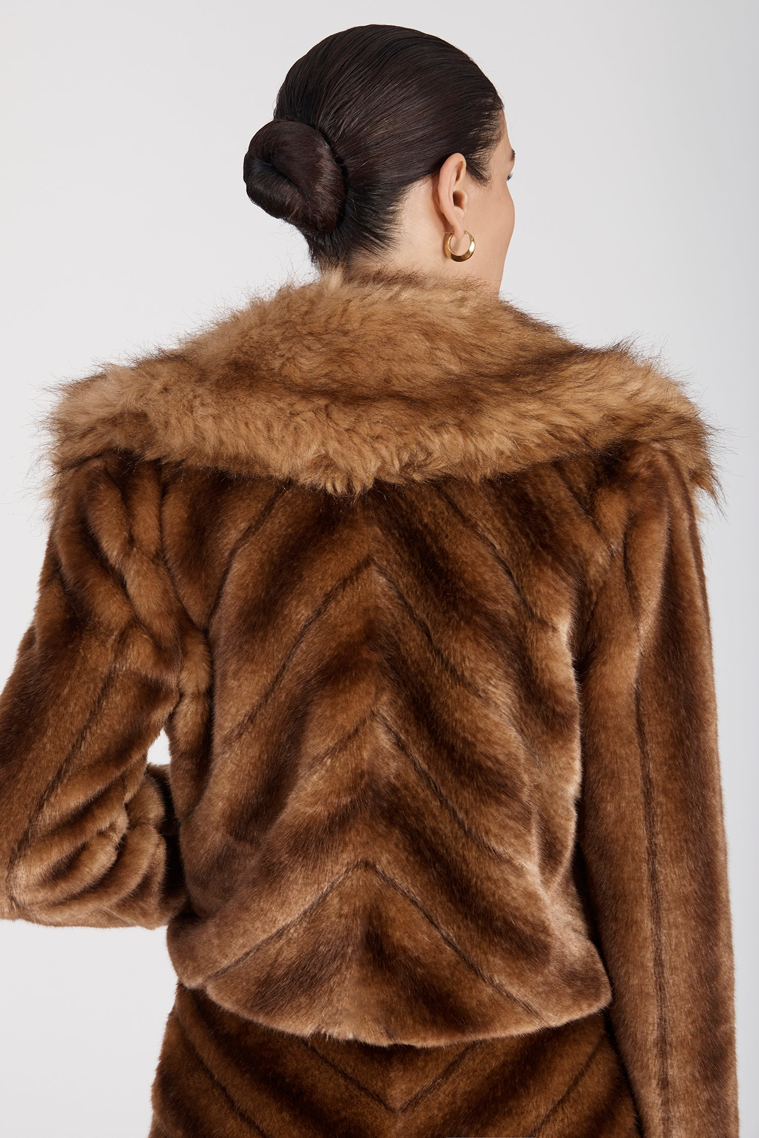 Marei1998's Oleander Faux Fur Short Jacket In Classic Brown Color. Featuring Wide Collar And Unique Front Buttons Made By An Italian Jewel Artisan. As Worn By The Model. Back View, Showing The Fur Texture Created By the Interesting Cut. Resort 2020 Collection - Furless Friendship.