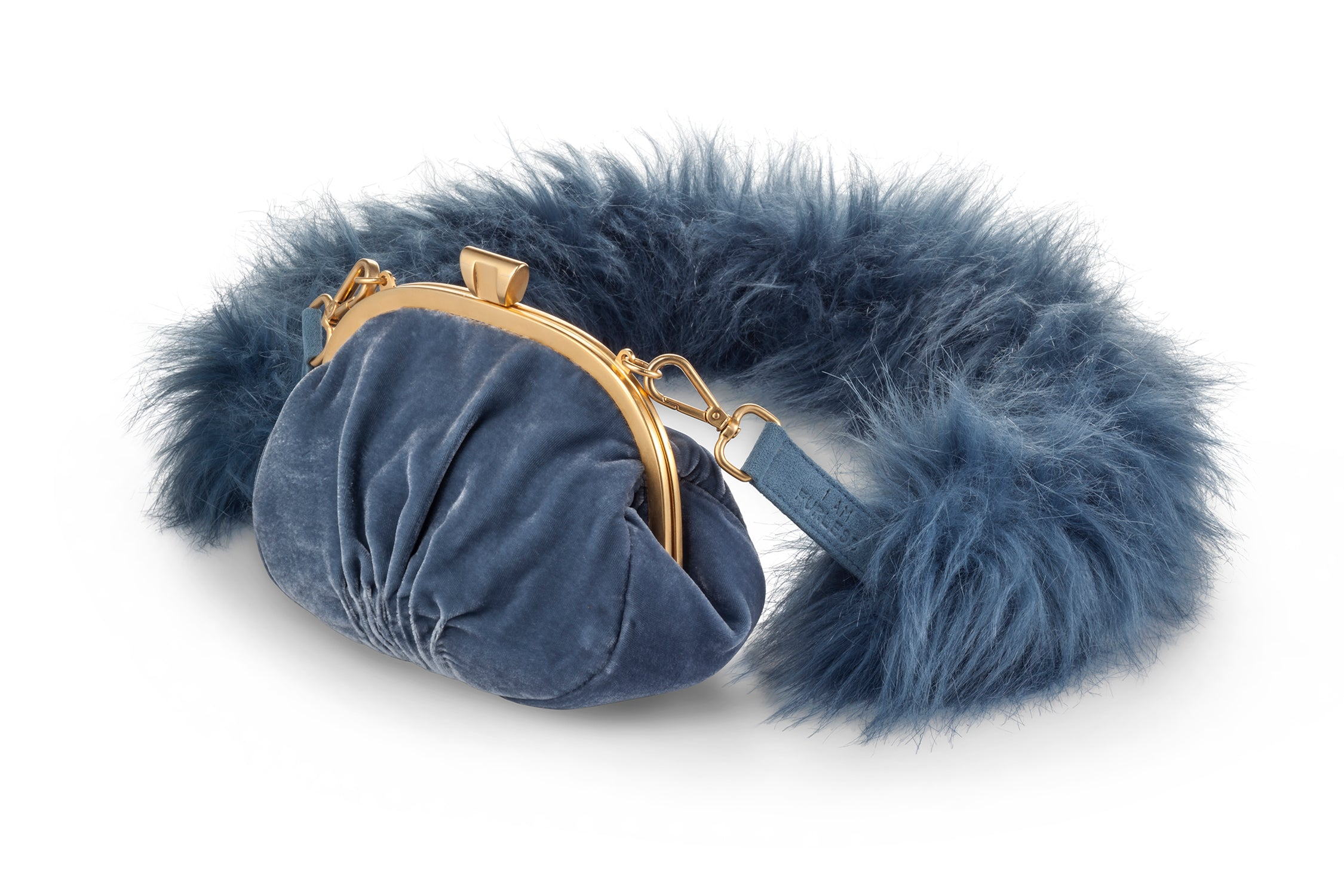 A Packshot Of Marei1998's Forget Me Not Velvet Purse In Light Blue Color. Made From Lustrous Velvet And Topped With Gold Plated Brass Clasp For Smooth Closure. The Puffy Silhouette In Light Blue Color Is Accentuated By A Lush Faux Fur Strap, Creating A Contemporary Vintage Look. Side View.