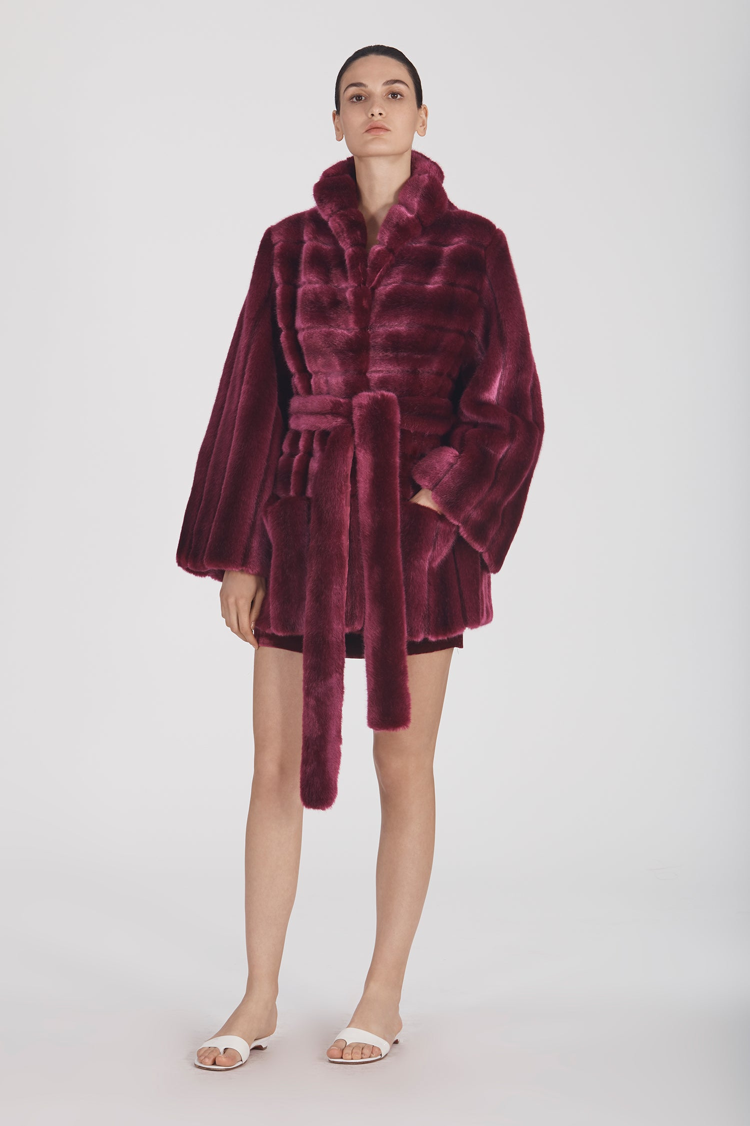 Marei1998 Yoshino Coat In Bold Raspberry Hue. Perfect For Cold Weather, This It Is Made From Plush Faux Fur, Which Feels So Warm And Comfortable. Cut In A Slight A-Lined Shape And Fully Lined, It Is Ideal For Smooth Layering. Front View.