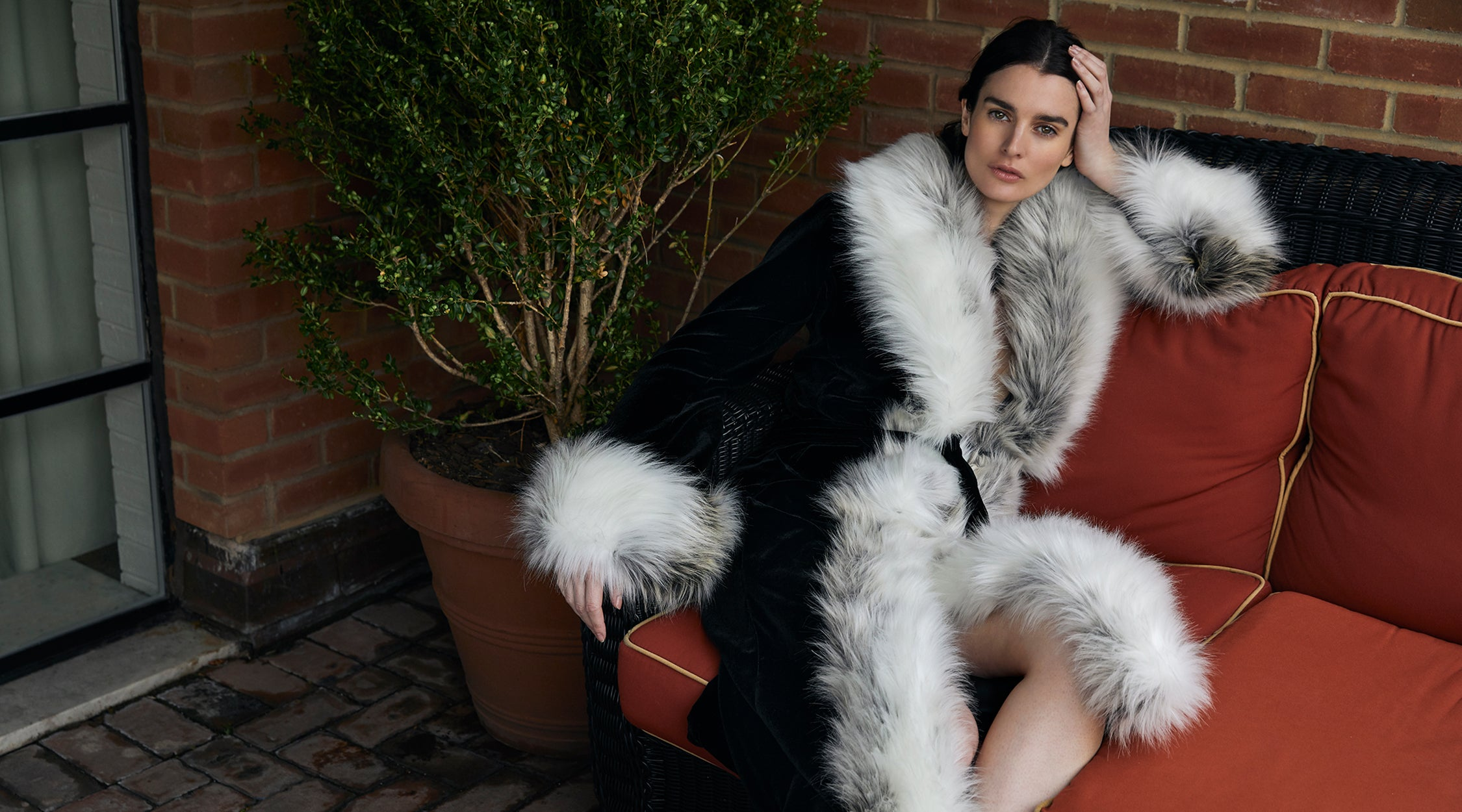 A Packshot Of Marei1998's Iconic Powderpuff Long Velvet Coat In Mixed Color. The Silk Velvet Material, Combined With Faux Fur Trims, Creates A Contemporary Vintage Look. Featuring Wide Lapel Collar And Bell Sleeves, It Is Finished With A Self-Tie Belt To Define The Waist. As Worn By The Model. Side View.
