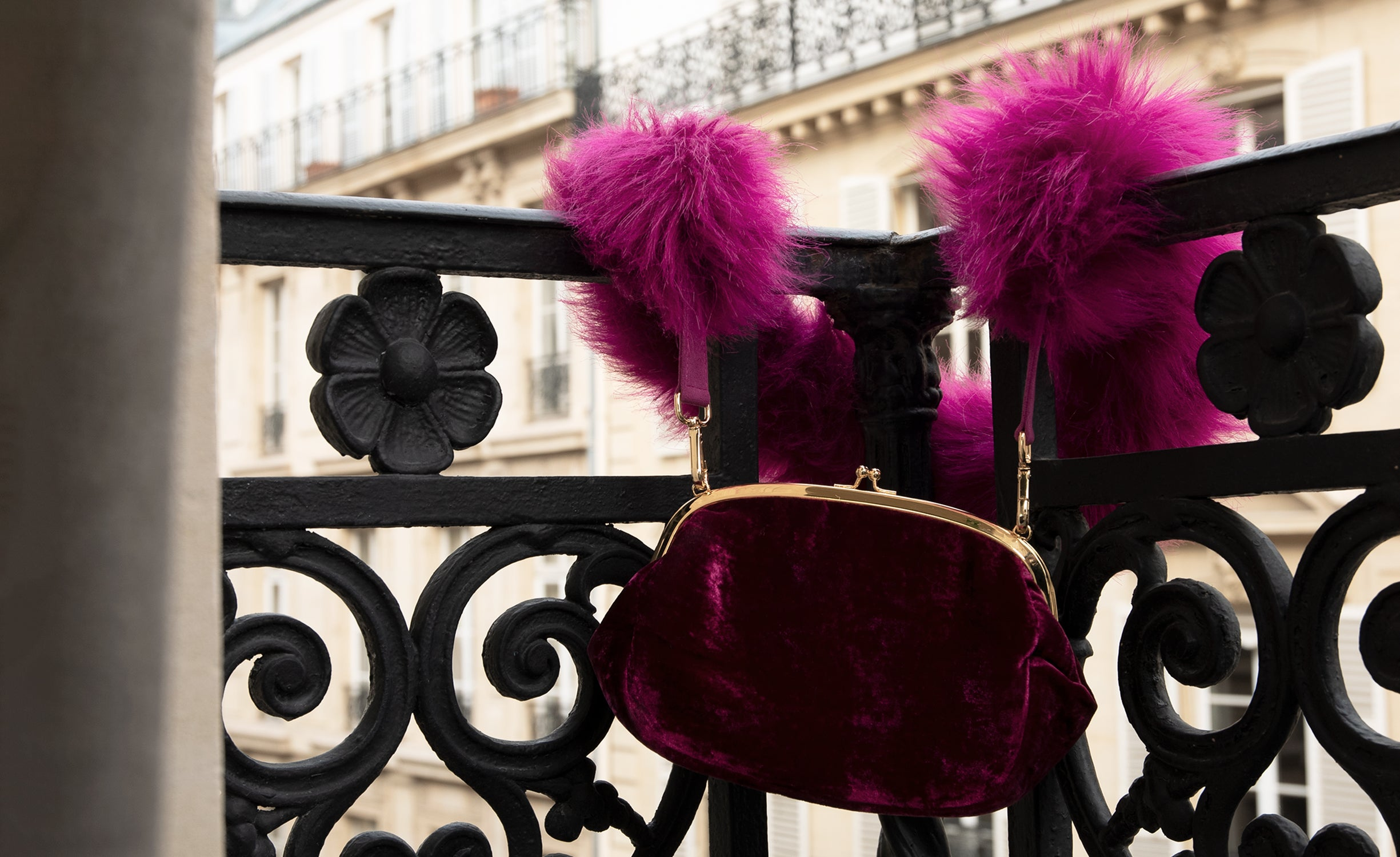 Marei1998's Forget Me Not Velvet Purse In Raspberry Color. Made From Lustrous Velvet And Topped With Gold Plated Brass Clasp For Smooth Closure. The Puffy Silhouette In Bold Raspberry Color Is Accentuated By A Lush Faux Fur Strap, Creating A Contemporary Vintage Look. Front View.