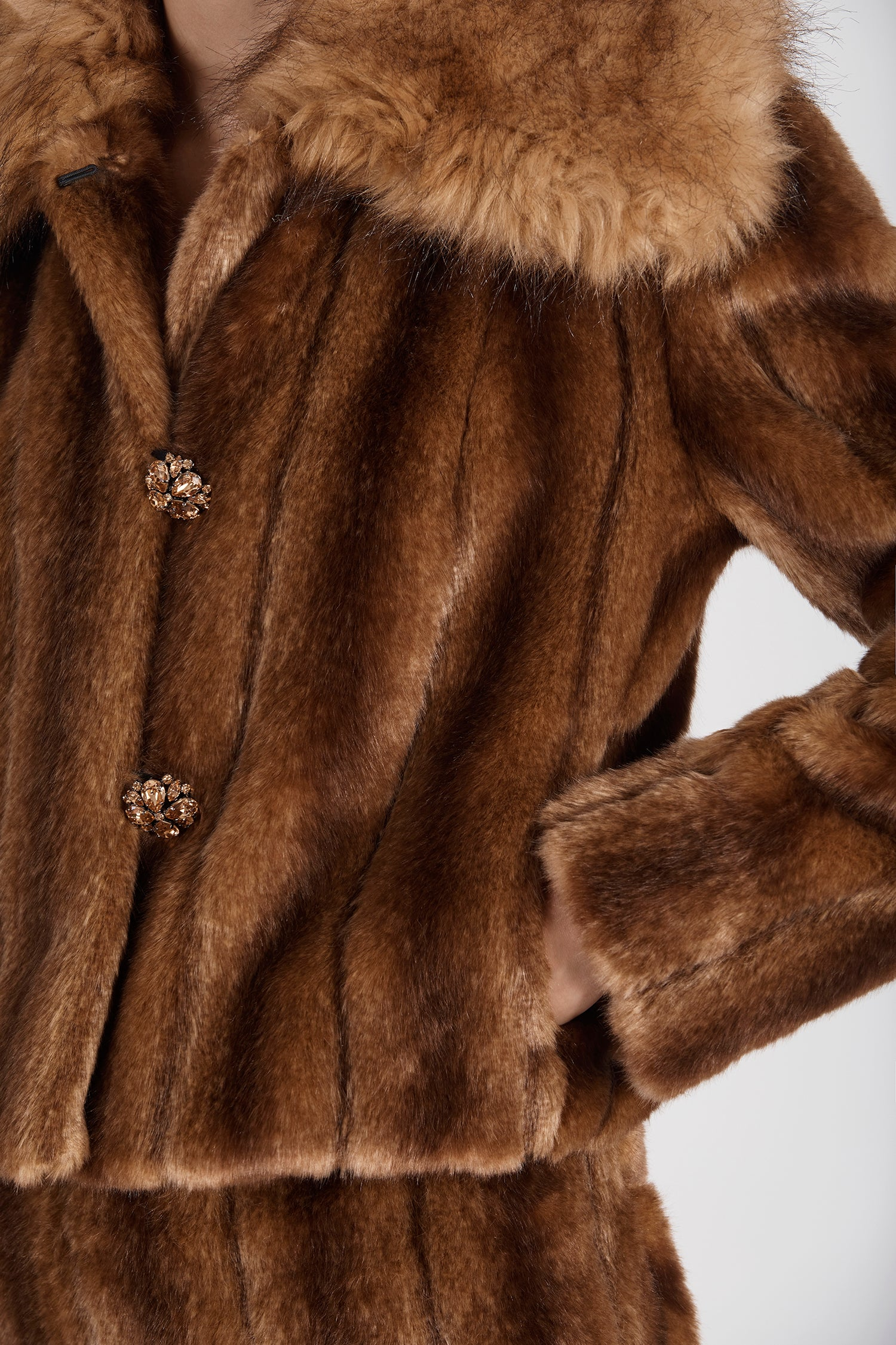Marei1998's Oleander Faux Fur Short Jacket In Classic Brown Color. Featuring Wide Collar And Unique Front Buttons Made By An Italian Jewel Artisan. As Worn By The Model. Close Up View on The Front. Resort 2020 Collection - Furless Friendship.