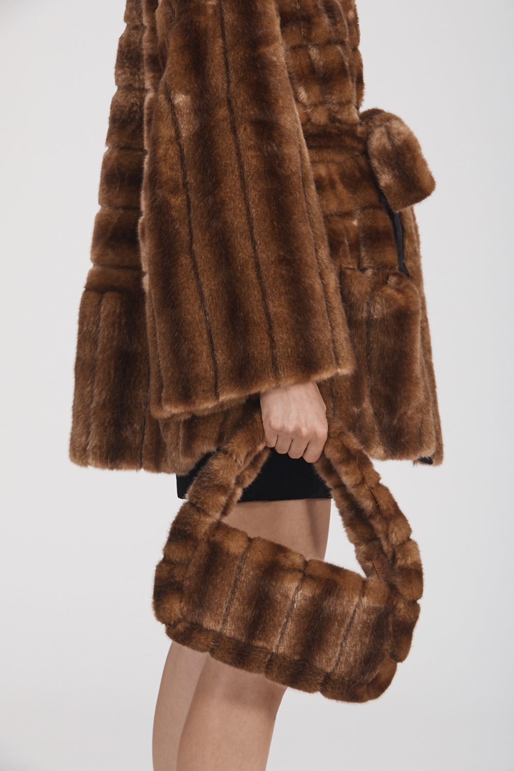 Marei1998 Yoshino Cot In Classic Brown Hue. Perfect For Cold Weather, This It Is Made From Plush Faux Fur, Which Feels So Warm And Comfortable. Cut In A Slight A-Lined Shape And Fully Lined, It Is Ideal For Smooth Layering. Side View.