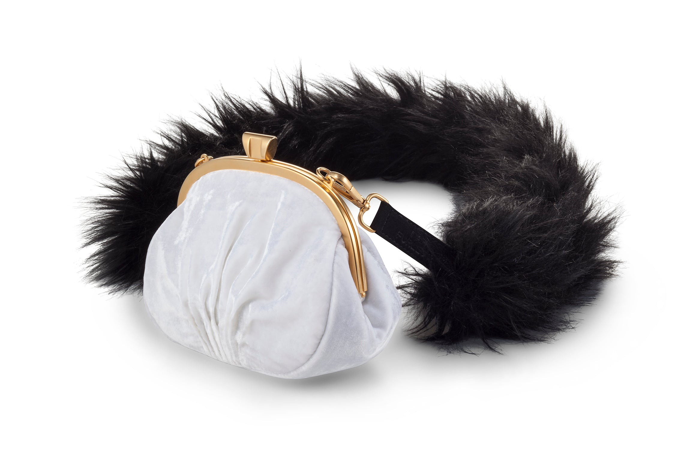 A Packshot Of Marei1998's Forget Me Not Velvet Purse In White Color. Made From Lustrous Velvet And Topped With Gold Plated Brass Clasp For Smooth Closure. The Puffy Silhouette Is Accentuated By A Lush Faux Fur Strap In Contrasting Black Color, Creating A Contemporary Vintage Look. Side View.