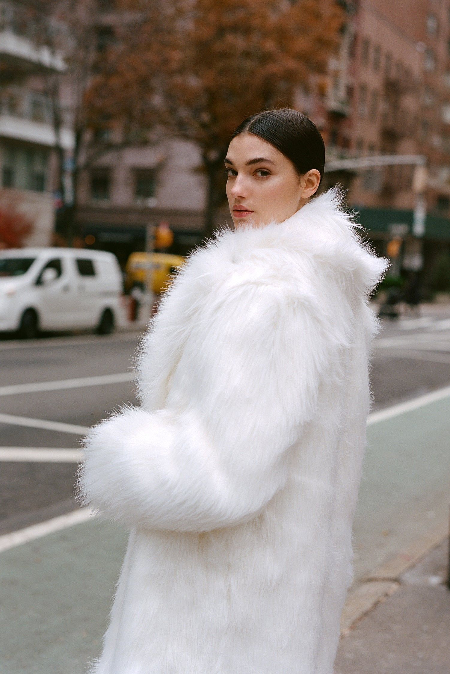Marei1998's Datura Long Faux Fur Coat In Ivory Color. Featuring A Slight A-Lined Silhouette, It Is Made From The Fluffiest Long Pile Faux Fur. Side View.